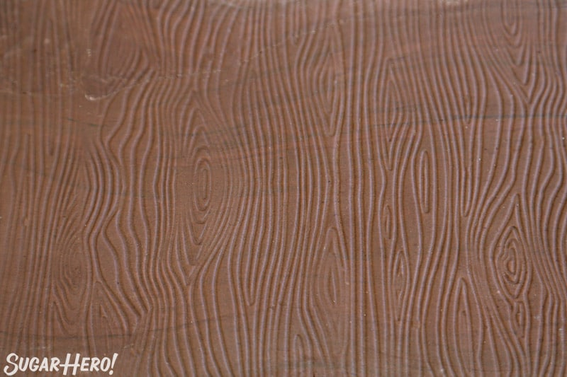 Close-up of brown fondant with wood grain texture