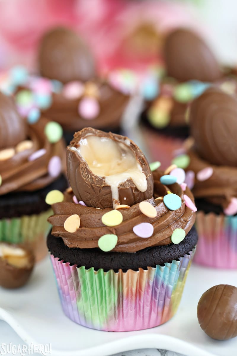 Chocolate cupcake with a creme-filled egg with a bite taken out of it