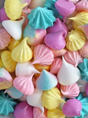 Colorful meringue cookies jumbled together on a plate