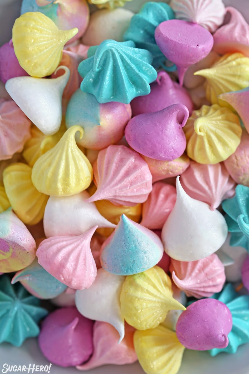 Overhead shot of colorful meringue cookies jumbled together on a plate