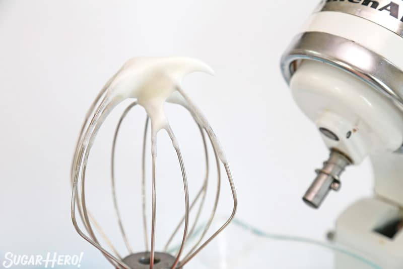 Whisk attachment showing meringue mixture with soft peaks