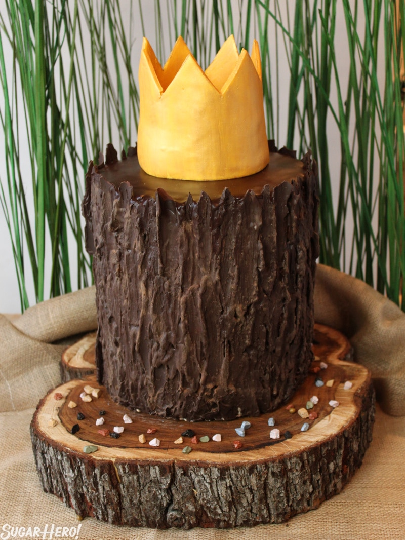 Where the Wild Things Are Birthday Cake - Photo of layer cake with a fondant crown on top.| From SugarHero.com