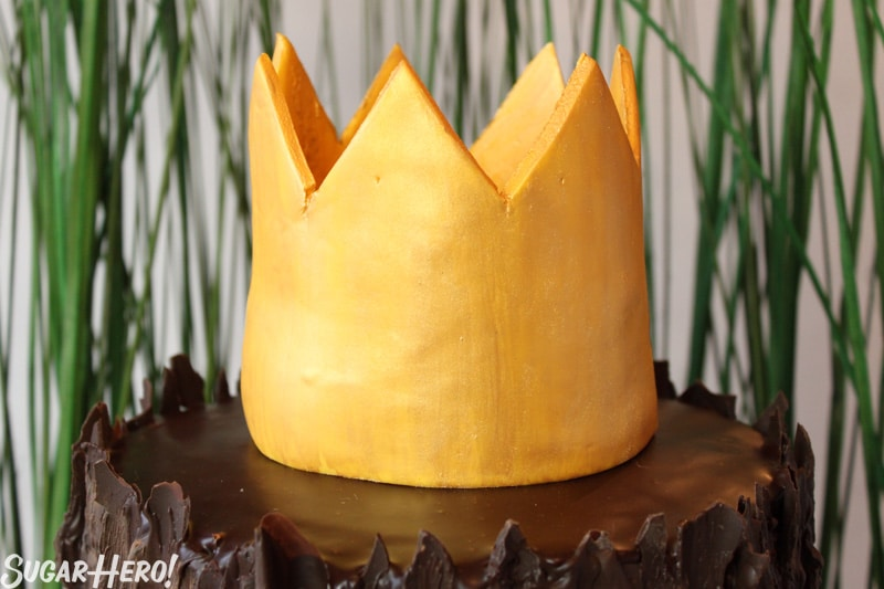 Where the Wild Things Are Birthday Cake - Close up shot of the gold fondant crown. | From SugarHero.com