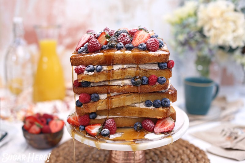 French Toast Cake on a cake stand | From SugarHero.com