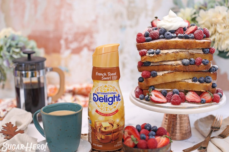 Picture of coffee mug, coffee creamer, and French toast cake on cake stand