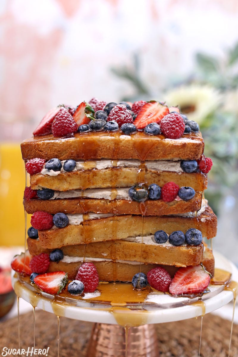 French toast cake with syrup streaming down the sides