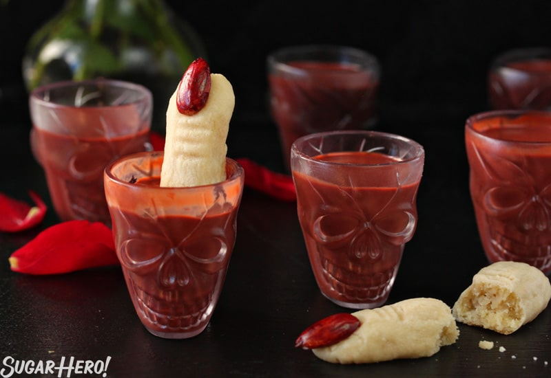 This Red Velvet Hot Chocolate - A straight shot of multiple skull glasses filled with hot chocolate. | From SugarHero.com