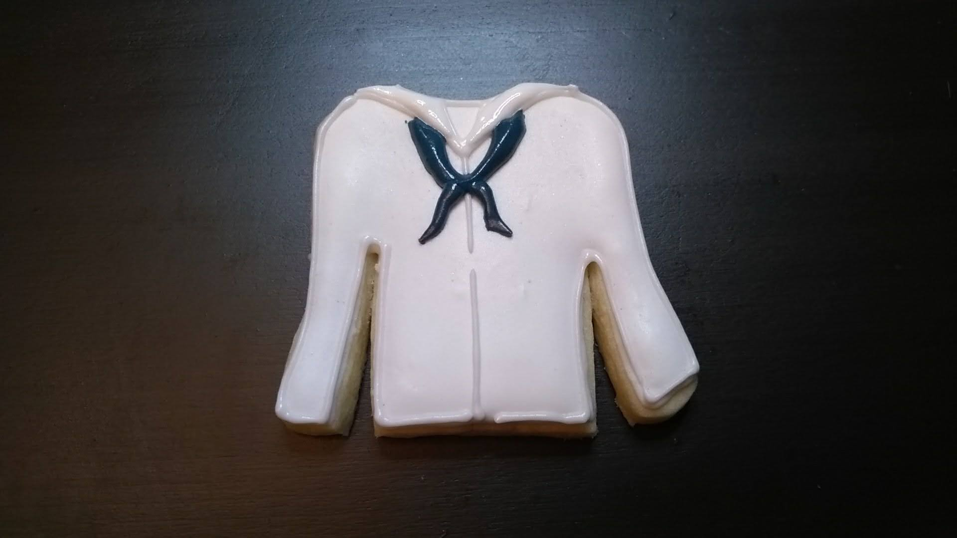 navy tunic royal icing cookie