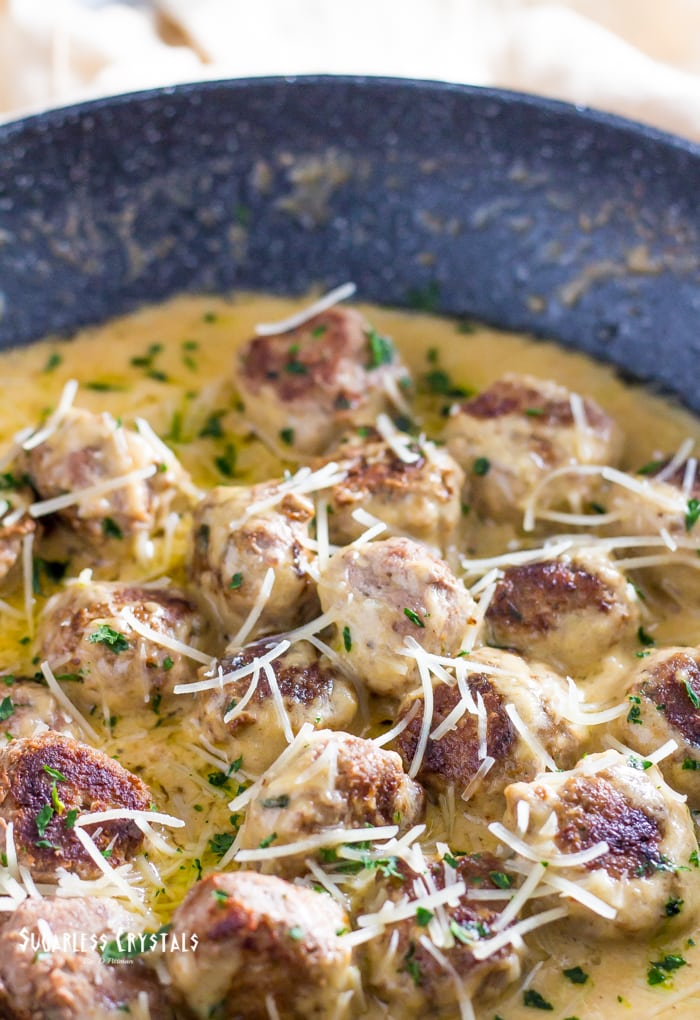 close up parmesan keto turkey meatballs with cheese sprinkled on top