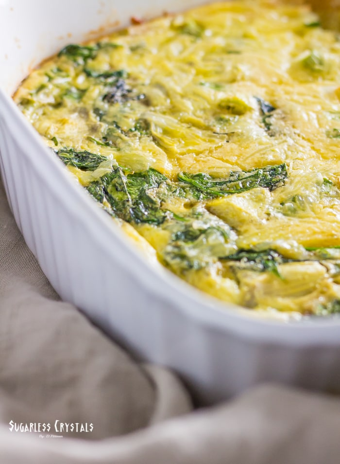 spinach and artichoke keto egg bake in 9x9 baking dish