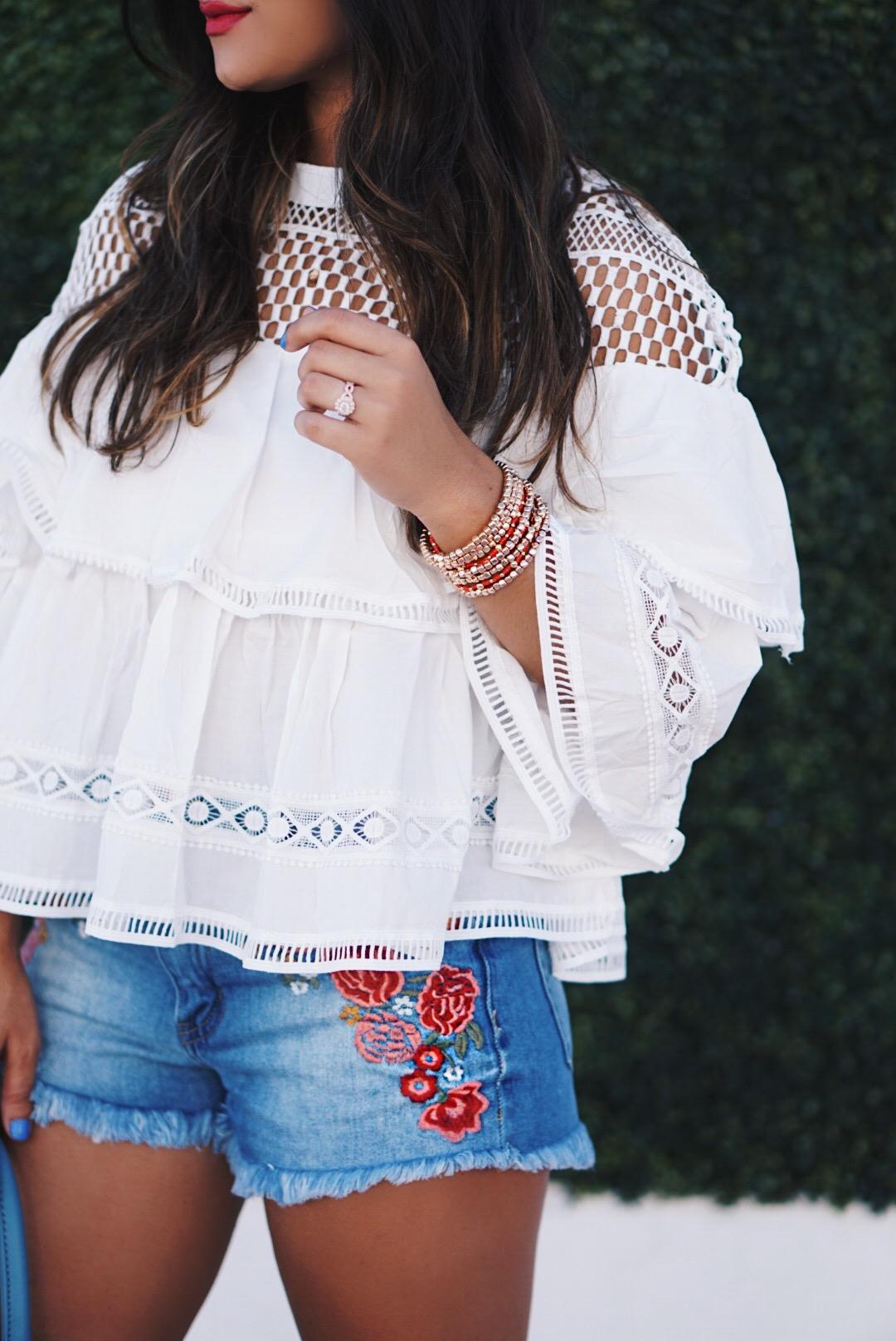 Sugar Love Chic blogger Krista Perez wearing white ruffle top and cutoff shorts