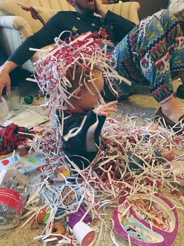 Playing with shredded paper Christmas morning.