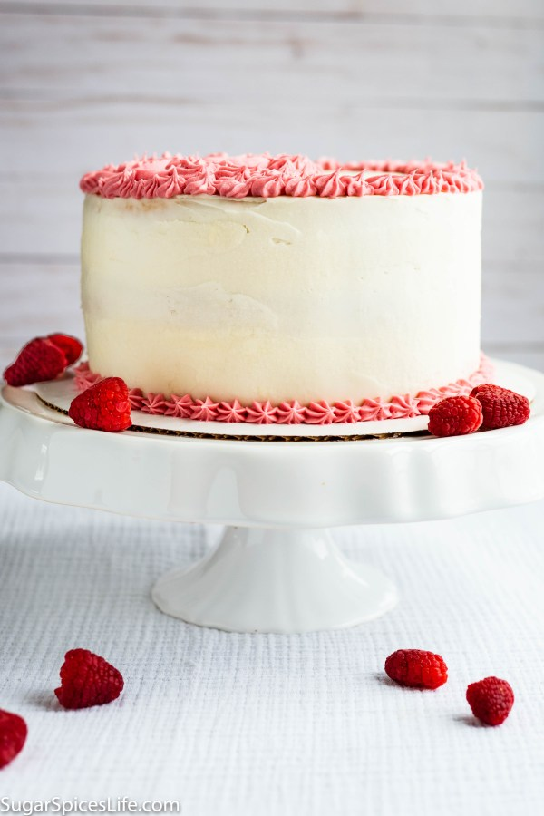 White Almond Cake with Raspberry Filling and Buttercream Frosting. Soft, white almond cake layers with a delicious raspberry filling, finished with raspberry and vanilla buttercream frostings. The perfect cake for any occasion!