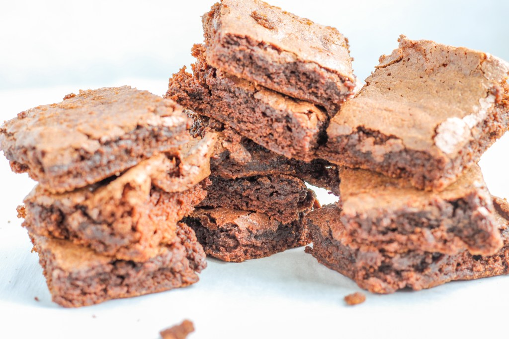 Crispy Top Fudgy Brownies. These brownies are fudgy and soft with a tasty, crispy sweet top. Baked in parchment paper so that even the sides are soft and chewy.