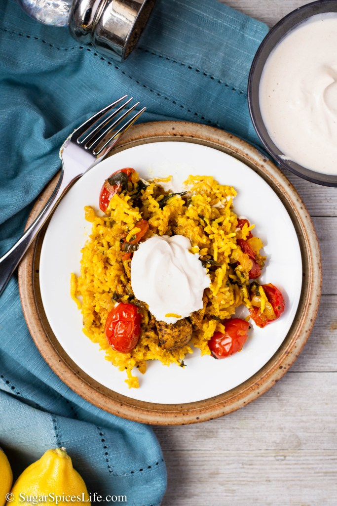 Middle Eastern Chicken and Rice with Tahini Yogurt Sauce. This dish is full of amazing flavor. The chicken and rice are cooked in one pot, making it easy to bake and easy to clean up!