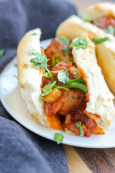 Asian Pork Meatball Sandwich. Pork meatballs with an Asian flare, topped with sauted onions and in a sub roll. Perfect for an easy but satisfying lunch or dinner.