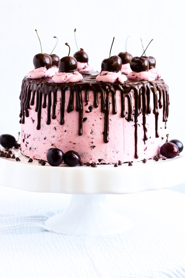 Chocolate Covered Cherry Cake. Chocolate cake with a cherry ganache filling, frosted with fresh cherry buttercream, topped with chocolate ganache and chocolate covered cherries.