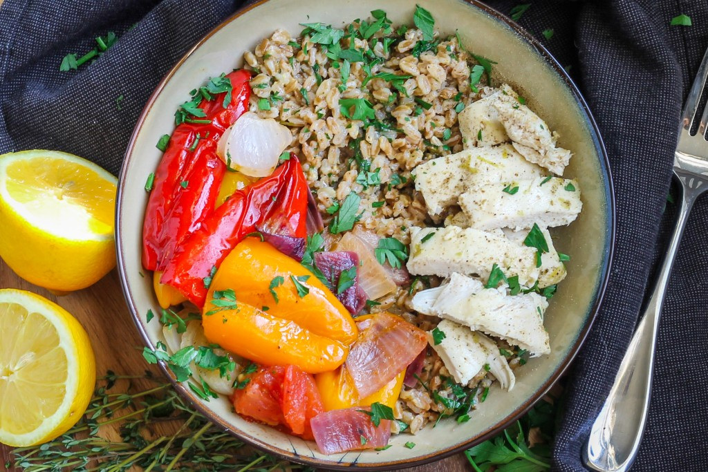 Chicken and Vegetable Farro Salad. Roasted or grilled chicken and vegetables, mixed together with farro, fresh herbs, and a tangy lemon vinaigrette.