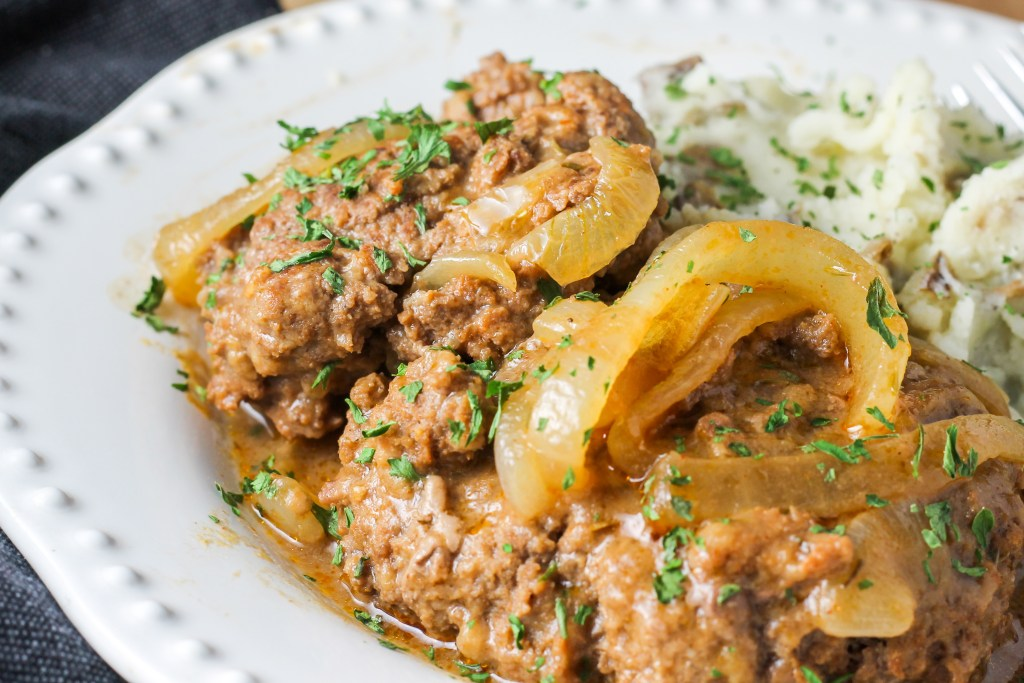 Salisbury Steak. Ground beef that is perfectly seasoned and topped with caramelized onions. The perfect comfort food meal.