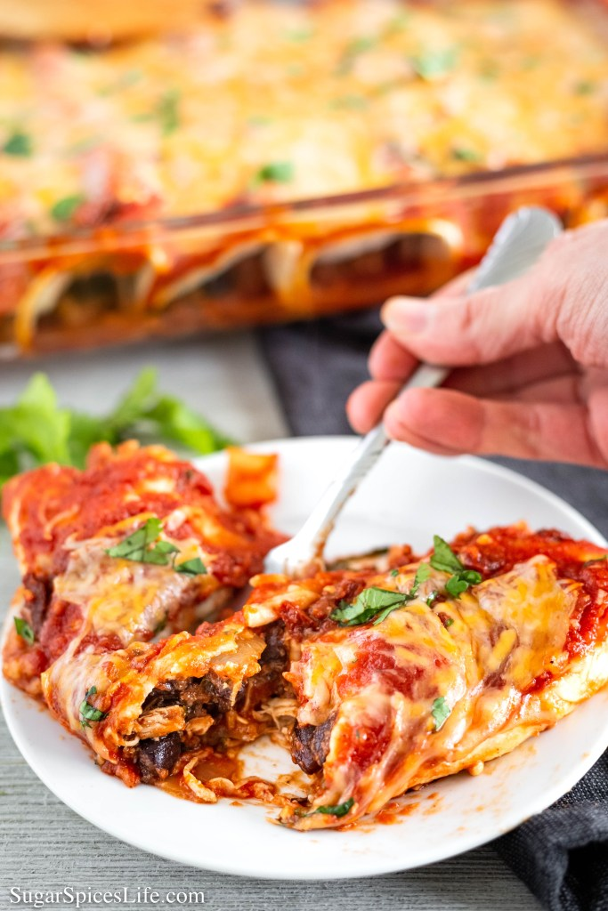 These Chicken and Andouille Sausage Enchiladas have a chicken and Andouille chicken sausage filling wrapped in a tortilla, and topped with a delicious enchilada sauce and melty cheese.