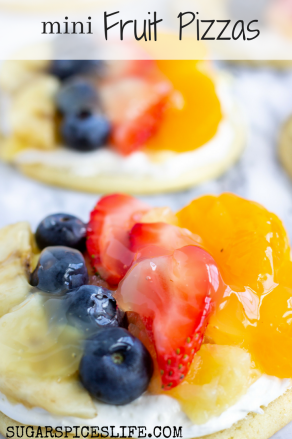 Mini Fruit Pizza: Individual sized fruit pizzas! Sugar cookie base with a cream cheese topping, fresh fruit, and a sweet glaze!
