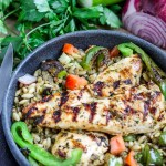 Greek Chicken over Orzo Lentil Salad. Delicious grilled chicken marinated with Greek spices on top of an orzo lentil salad with an herb vinaigrette and fresh vegetables.