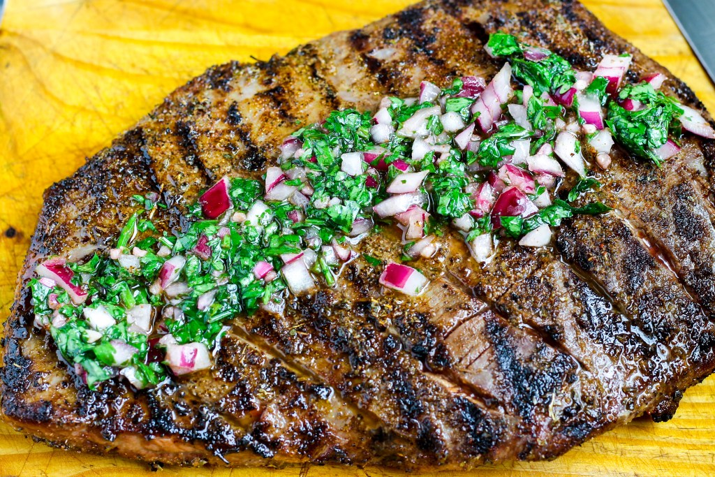 Flank Steak with Chimichurri Sauce. Deliciously seasoned flank steak grilled to your desired level and topped with a tasty chimichurri sauce. Quick to make and tastes amazing!