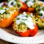 Lemongrass Chicken Stuffed Peppers. Chicken in a savory lemongrass sauce with white beans and coconut rice, cooked in bell peppers, and served with a lemongrass yogurt sauce. Healthy, filling, and delicious!