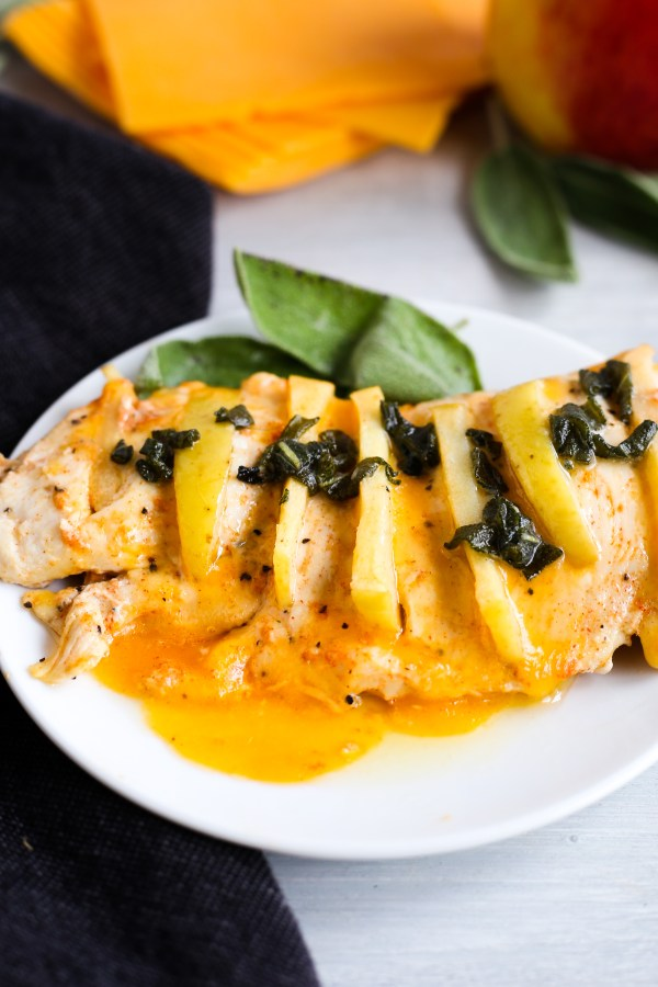 Apple Stuffed Chicken with Sage Sauce. Juicy chicken breasts stuffed with cheddar cheese and apple, and topped with a savory butter sage sauce. Easy to make of full of delicious flavor!