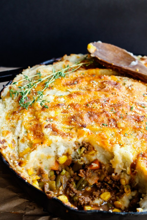 Skillet Shepherd's Pie. Deliciously seasoned beef and vegetables topped with creamy mashed potatoes and baked in a cast iron skillet. Pure, delicious comfort food.