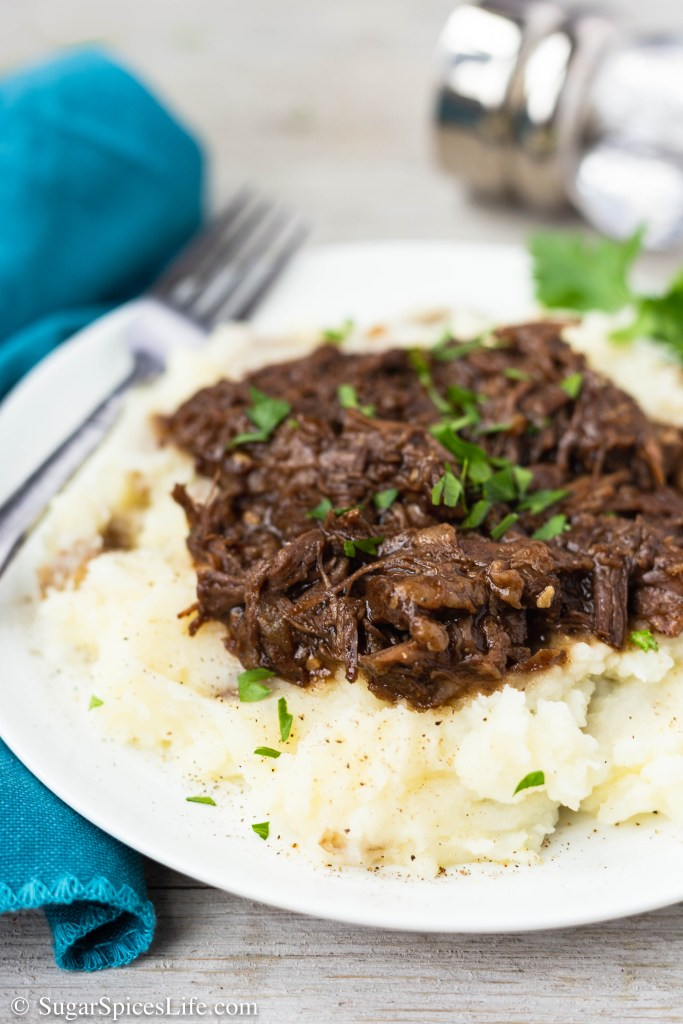 This Honey Balsamic Beef with Buttermilk Mashed Potatoes (Instant Pot) has tender, shredded beef cooked in the Instant Pot, covered in a delicious honey balsamic sauce, and served over creamy buttermilk mashed potatoes.