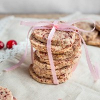 Cranberry Orange Shortbread Cookies. Soft, orange flavored shortbread cookies with bits of cranberry. Festive and delicious!