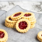 Raspberry Almond Cookies. Soft, almond shortbread cookies sandwiching raspberry jam. Deliciously perfect!