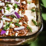 Chicken Mole Enchiladas. Chicken with sauted vegetables, rolled in tortillas, and baked in a delicious mole sauce. The sauce is easy to make but full of delicious flavor!