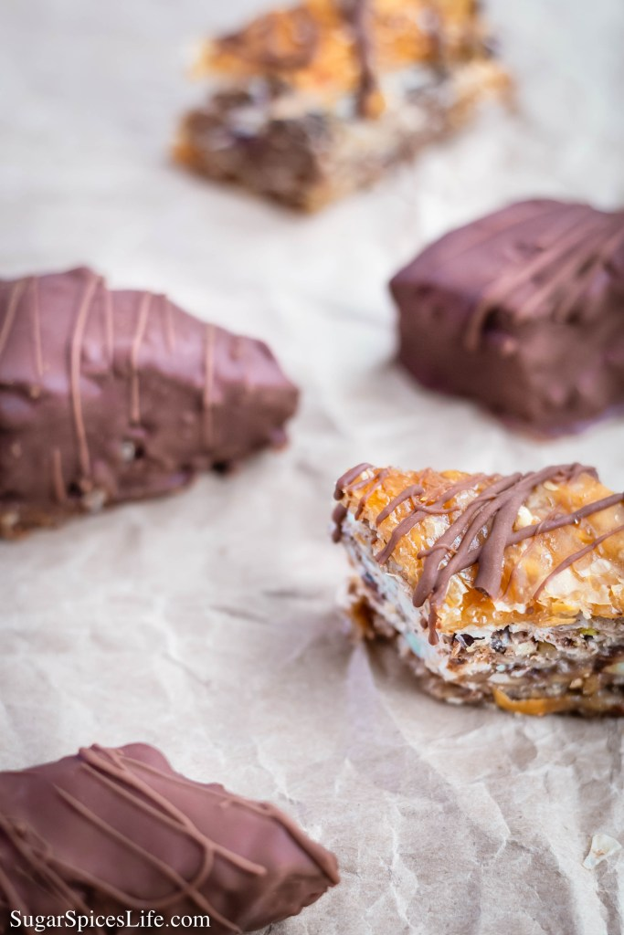 This Chocolate Baklava has phyllo sheets filled with nuts, spices and chocolate chips, and drenched with a decadent honey sauce. And finally, the pieces are either drizzled or fully coated with semi-sweet chocolate!