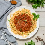 This Greek Meat Sauce with Spaghetti has a thick, flavorful meat sauce, with hints of cinnamon and cloves, served over spaghetti noodles. This is an amazing, delicious alternative to traditional spaghetti sauce.