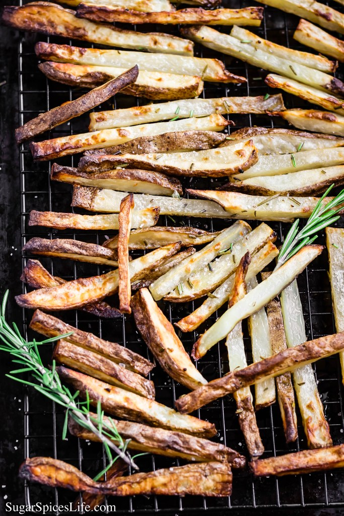 These Oven Baked Rosemary Fries are crispy and delicious enough to rival deep fried fries, while being less messy to make and much healthier to eat!