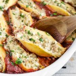 These Sausage Stuffed Shells have jumbo pasta shells stuffed with sausage and three types of cheeses, baked in a delicious homemade marinara sauce.
