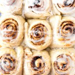 These delicious rolls are large, soft yeast rolls with a cinnamon orange filling and orange drizzle icing. Orange Cinnamon Rolls are perfect for breakfast, a holiday brunch, or just an afternoon snack.