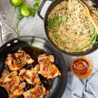 These Sriracha Honey Chicken Thighs have deliciously sweet and spicy chicken served over a delicious cilantro lime quinoa. A dinner that's full of flavor and easy to make!