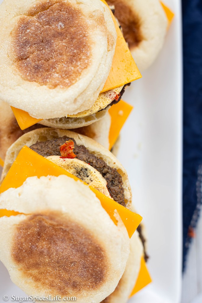 Savory, turkey sausage patties topped with baked eggs and melted cheese inside an English muffin. These homemade Freezer Breakfast Sandwiches can be heated up for a quick, delicious weekday breakfast.
