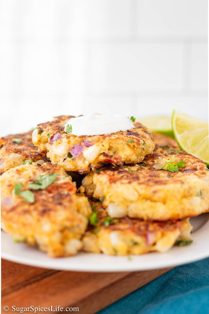 Fresh corn combined with corn muffin mix, vegetables, and spices, then fried to a delicious crisp. These Skillet Fried Corn Fritters are a perfect snack, appetizer, or side dish!