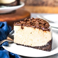 A chocolate graham cracker crust with a peanut butter cream cheese filling, and topped with a chocolate ganache. This Instant Pot Peanut Butter Chocolate Cheesecake is quick to put together and much easier to make than a traditional cheesecake!
