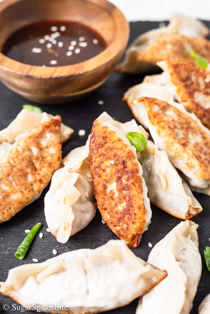 Flavorful pork and vegetables cooked with garlic and ginger, then wrapped and pan fried in a dumpling wrapper. These Garlic Ginger Pork Potstickers are a super tasty dinner for any night!
