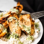 Chicken tenders marinated in a yogurt, garam masala sauce, grilled on a stove top or gas grill, and topped with an addictively creamy cilantro sauce. These Chicken Tikka Masala Tenders are packed with flavor.