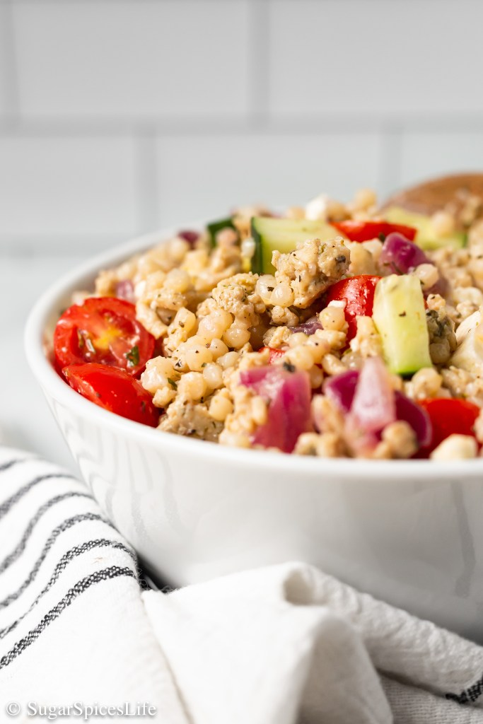 Ground chicken, vegetables, and feta cheese tossed together with pearl couscous in a homemade vinaigrette. This Chicken and Pearl Couscous Salad is a quick, healthier dinner that is full of flavor!