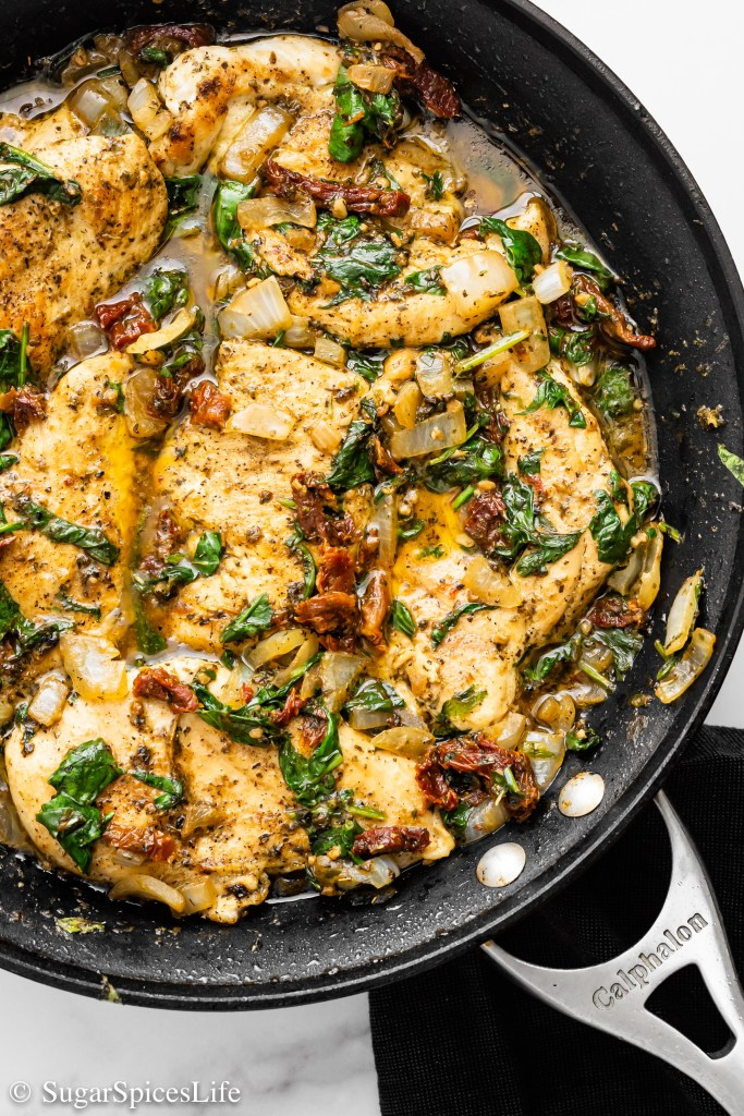 Chicken in a creamy, flavorful sauce, topped with spinach and sun-dried tomatoes. Made with coconut milk, this Skillet Tuscan Chicken has less dairy than many Tuscan Chicken recipes, but no shortage of flavor!