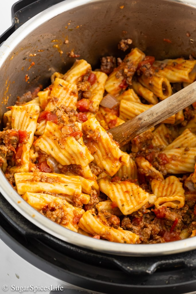 Beef and sausage tomato sauce cooked with rigatoni pasta in an Instant Pot or other pressure cooker. Because this Instant Pot Inauthentic Pasta Bolognese is cooked in one pot, there's less mess, less time and work involved, but no less flavor!