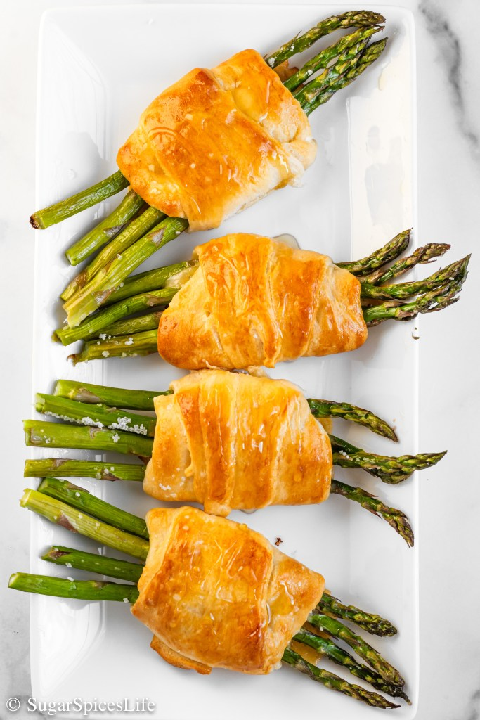 Asparagus with melted Gouda cheese and sage wrapped up in a croissant, baked until perfectly golden, and then drizzled with honey. These Asparagus Croissants are a unique and delicious side dish or appetizer that will have everyone asking for seconds.