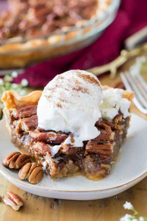 Pecan pie topped with ice cream